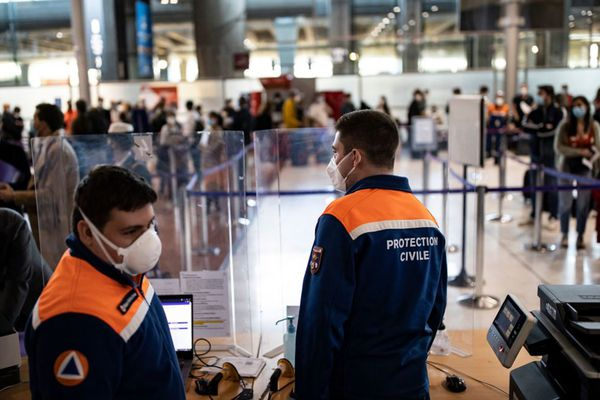 Members of the Civil Protection man a Covid-19 control point where passengers from specific countries register for Covid-19 tests upon their arrival at Roissy Charles de Gaulle airport in Roissy near Paris, on April 25, 2021. (Ian Langsdon/Pool/AFP via Getty Images/TNS)
