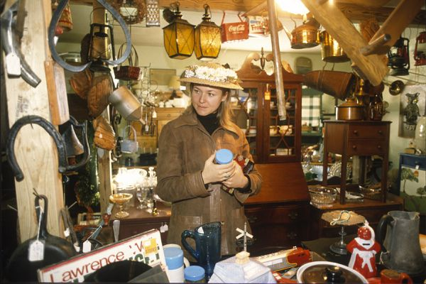 Jewel looks over goods in an antique store in Stanardsville, VA. In 1996 she said that she would like to collect things, if she had a home, but now she just shares a small house with a friend and doesn't have room. January 20, 1996. (Anne Raup / ADN archive 1996)