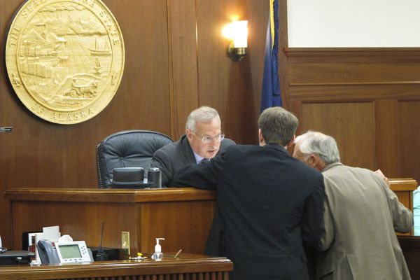 Alaska House House Speaker Bryce Edgmon, left, speaks with Minority Leader Lance Pruitt and Majority Leader Steve Thompson, right, on the House floor session in Juneau, Alaska Monday, July 22, 2019. The Alaska House has failed by one vote to approve funding for a state infrastructure package. Majority lawmakers needed support from minority Republicans to reach the 30-vote threshold required to access the constitutional budget reserve fund, which the capital budget would use. A similar vote Sunday, July 21, failed by five votes. (AP Photo/Becky Bohrer)