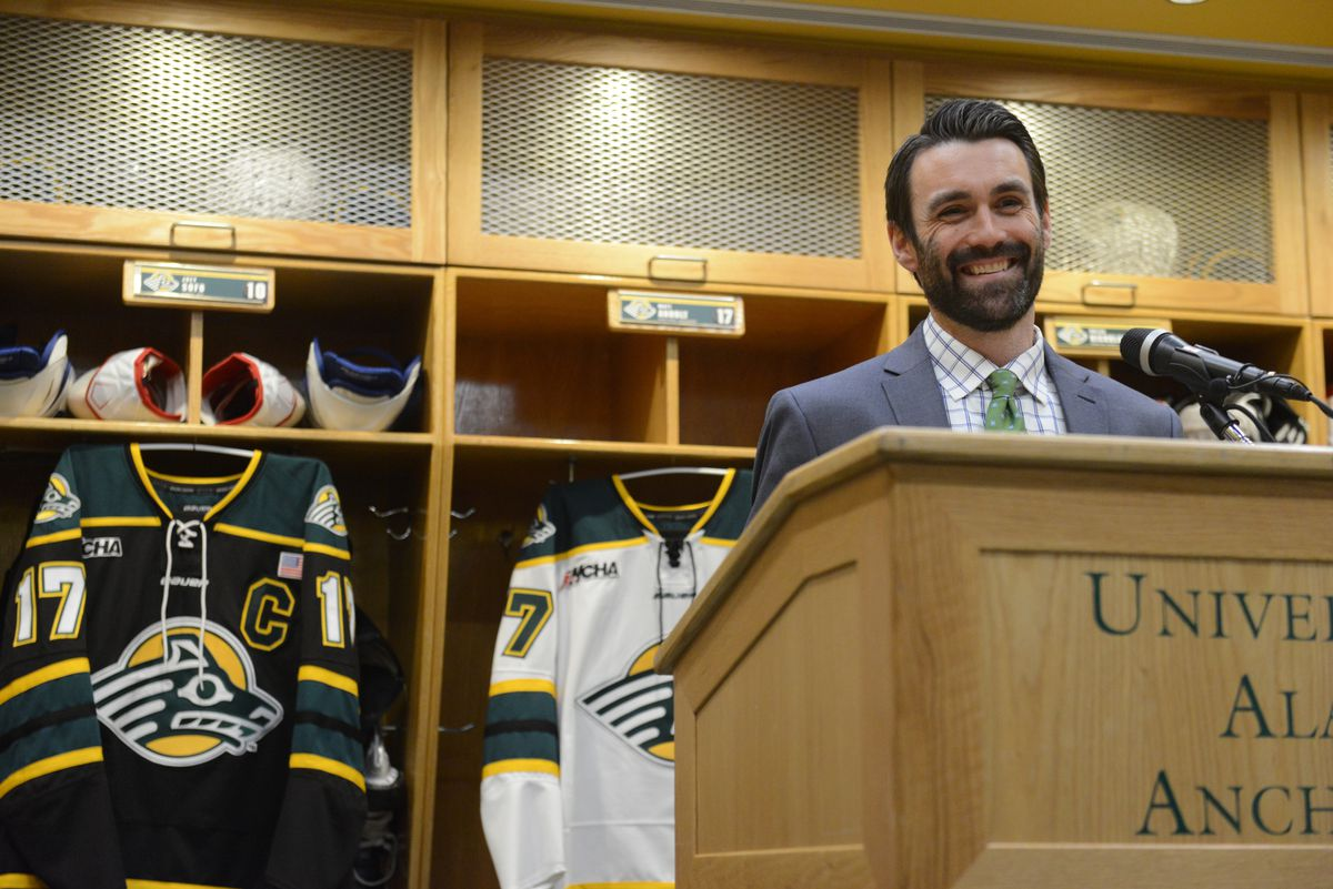 Matt Curley, the newly named UAA Seawolf head hockey coach, talks to the press in the Seawolf locker room at the Wells Fargo Sports Center in Anchorage, AK on Saturday April 21, 2018. (Bob Hallinen / ADN)