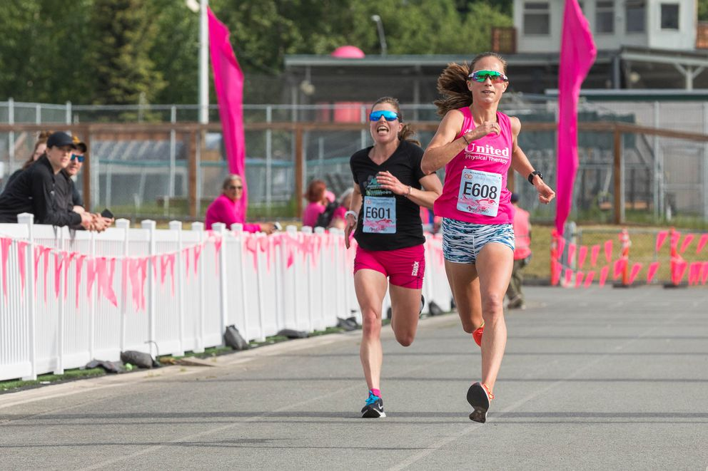 Anna Dalton, right, holds off Rosie Brennan to win the Alaska Run For Women Saturday, June 8, 2019 in Anchorage. Dalton won the 5-mile race with a time of 27:46. (Loren Holmes / ADN)