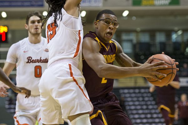 Central Michigan's Shawn Roundtree works toward the hoop around Sam Houston State's Josh Delaney. Sam Houston State faced Central Michigan in the opening round of the Great Alaska Shootout men's basketball tournament on November 22, 2017. (Marc Lester / ADN)