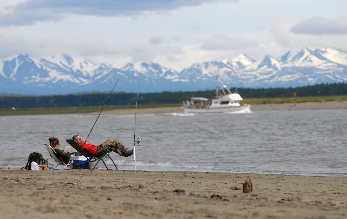 Shantel Wiley and Chris Neid of Soldotna fish for halibut on the north Kenai beach at the mouth of the Kenai River on Sunday, June 16, 2019. (Matt Tunseth / ADN)