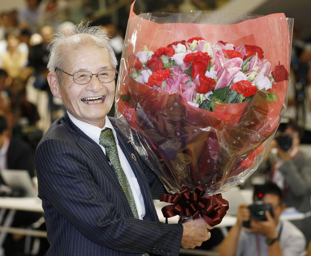 Akira Yoshino of Asahi Kasei Corporation poses with a bouquet of flowers in Tokyo Wednesday, Oct. 9, 2019, following an announcement that he was awarded the Nobel Prize in chemistry. (Yuta Omori/Kyodo News via AP)