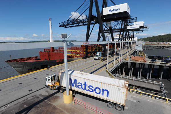 Containers come and go as the 710-foot Matson, Inc. vessel Matson Tacoma, at left, prepares for an evening departure to Kodiak on Tuesday afternoon, May 23, 2017, at the Port of Anchorage. (Erik Hill / ADN)