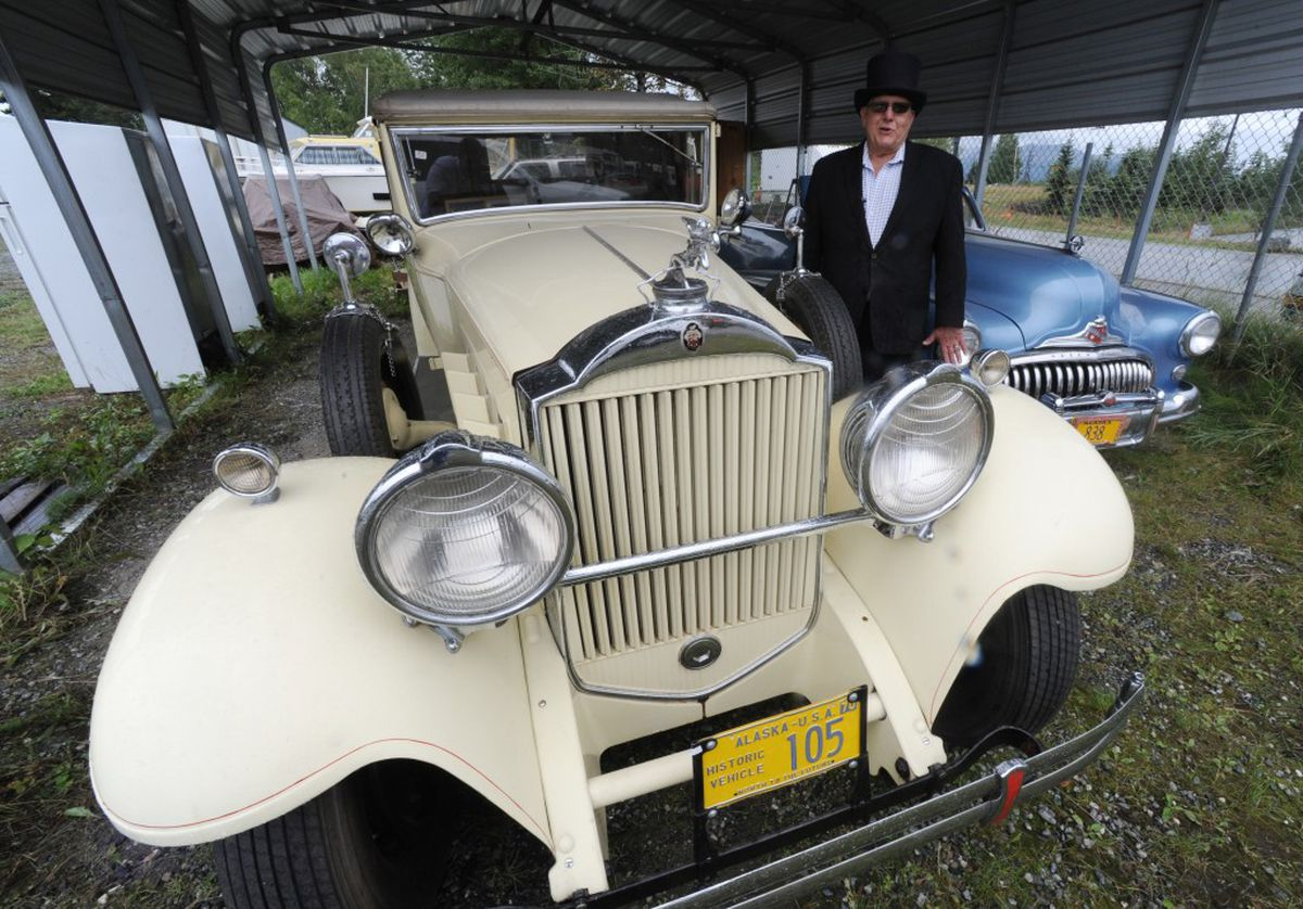 One of the first cars to be driven up the Alaska Highway is going up ...