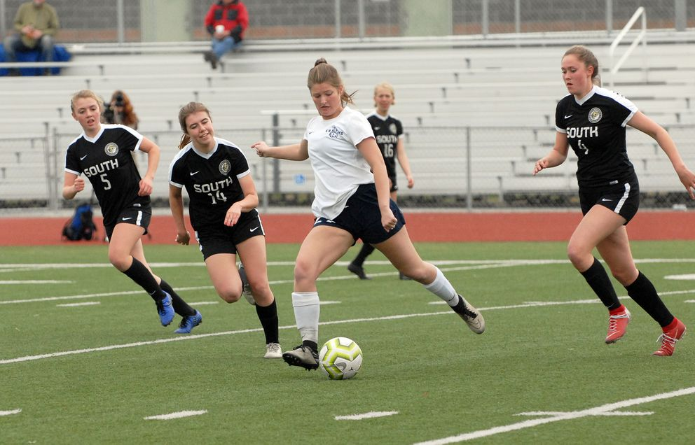 Eagle River's Sydney Swanson kicks the ball during a 2-0 loss to South. (Matt Tunseth / Chugiak-Eagle River Star)