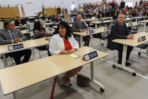 Rep. Cathy Tilton, R- Wasilla, and Rep. David Eastman, R-Wasilla, right, were some of the state legislators who gathered for a special session at Wasilla Middle School on Monday. A larger group of lawmakers met in Juneau. (Bill Roth/ADN)