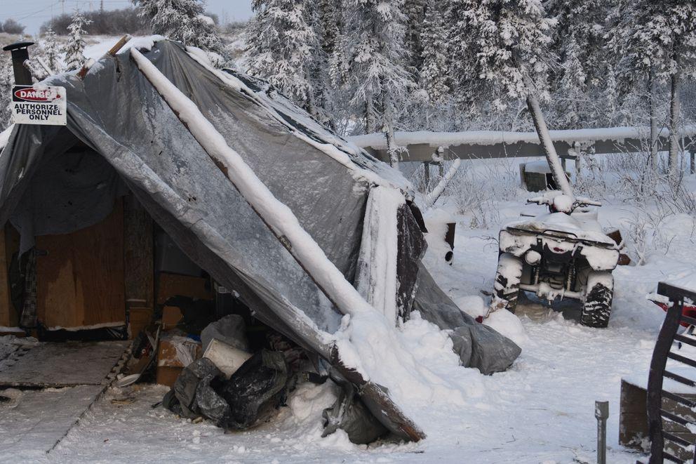 Six members of the Coffin family currently live in a 12-by-12-foot shelter made of trees, plywood and tarps in Noorvik. After applying for years, they expect to move into a home that is currently under construction in the next couple months. (Marc Lester / ADN)