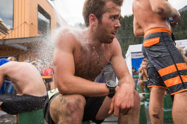 Conor Deal gets hosed off after finishing the 90th Mount Marathon race on Tuesday, July 4, 2017 in Seward. (Loren Holmes / Alaska Dispatch News)