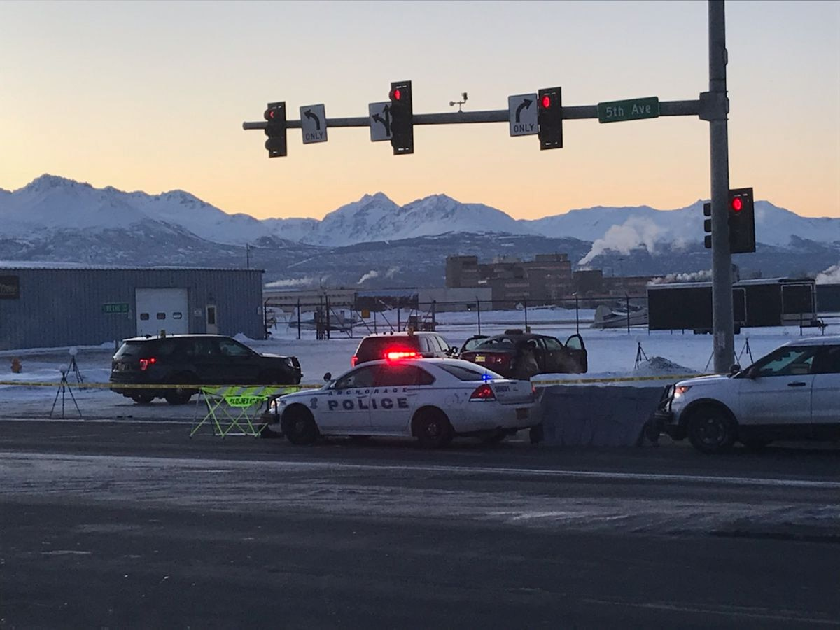 Anchorage Police investigate an officer-involved shooting Sunday, Feb. 16. One male was fatally shot after he fired at two officers, police said. One of the officers was wounded by gunfire. (Tess Williams / ADN)