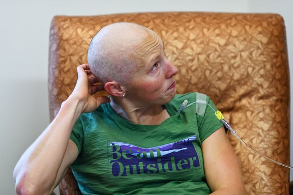 Kikkan Randall cries after reading a letter of support that was sent to her cancer treatment clinic on August 21, 2018. (Marc Lester / ADN)