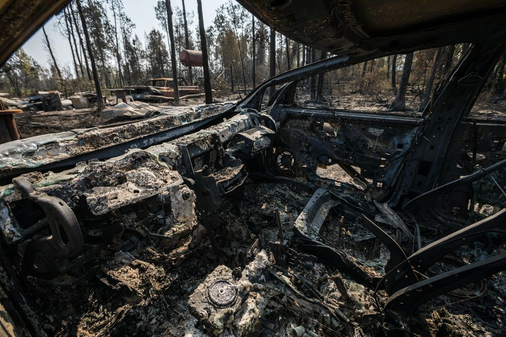 A car is burned Friday, Aug. 23, 2019 in Willow. The property was destroyed on Sunday by the McKinley Fire, which burned so hot that it melted the windshield in the car. (Loren Holmes / ADN)