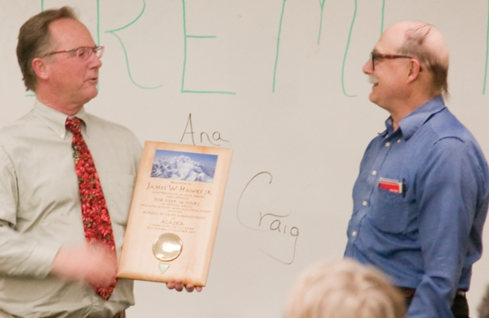 James William Hawke Jr. (right) receives an award from his former boss Michael Schoder (left) for his 40 years of service at the Bureau of Land Management in Alaska. Hawke was killed in a hit-and-run in Anchorage on Monday, Sept. 5, 2016. (Tasha Huhta, BLM)