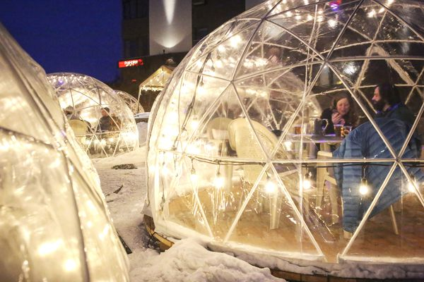 People dine in the PubHouse restaurant 's outdoor dining domes at the Inlet Tower in Anchorage on Saturday, Nov. 28, 2020. (Emily Mesner / ADN)