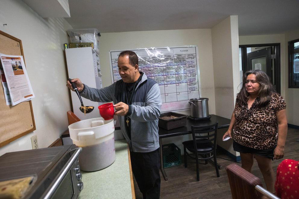 Tai Afe, an operation technician at Sitka Place, serves soup provided by the Downtown Soup Kitchen to resident Trish Sabon on Thursday, July 18, 2019. Sitka Place, which is operated by RurAL Cap, provides permanent supportive housing for homeless individuals with serious mental illness. 'I like it here, ' said Sabon. 'It's safe here. ' She is worried about where she would go if Sitka Place were to close. 'The shelter is turning away people, ' she said. 'Now we don't have that option either. ' Sabon pays $50 a month for her apartment. (Loren Holmes / ADN)