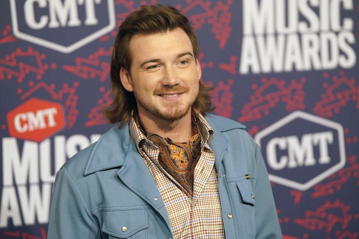 FILE - Morgan Wallen arrives at the CMT Music Awards in Nashville, Tenn. on June 5, 2019. Wallen has apologized after a video surfaced showed him shouting a racial slur. The video, which was first published by TMZ, showed him outside a home in Nashville, Tennessee yelling profanities. (AP Photo/Sanford Myers, File)