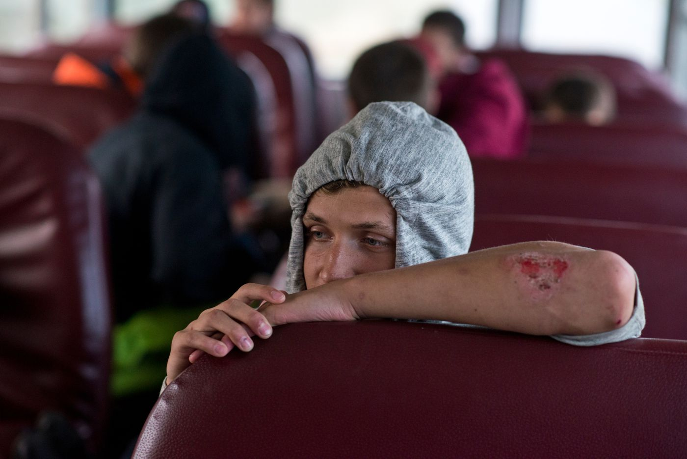 Zasima Martushev sits on the bus following a 33-0 loss to Nikiski. (Marc Lester / Alaska Dispatch News)