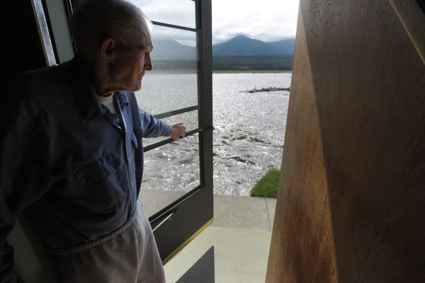 Ed Musial, 94, looks at the current cutting away his land behind the home he still occupies with his wife Val, 90, that they began building in 1959 on a 6.56 acre homestead land patent that he acquired in 1952 at mile 64.5 of the Glenn Highway north of Sutton. The Matanuska River was threatening to wash away their home on Wednesday, July 5, 2017, a day after the Johnson's 1940's homestead cabin was swallowed up by the river. (Bill Roth /ADN)
