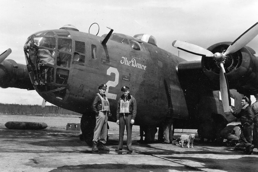 "Airmen stand next to ""The Deuce,"" a B-24D that flew bombing missions in the Aleutians and Kuril Islands. (Army Air Force, 11th Air Force Instrument Training School, 613ABW Hist. Office)"