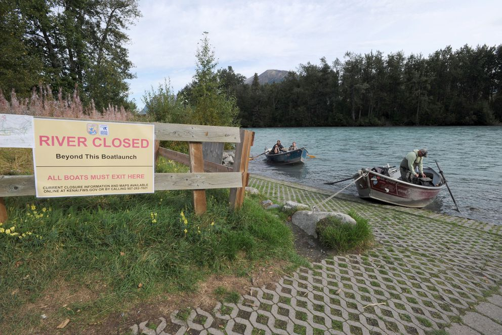 Drift boats pull into Sportsman's Landing on the Kenai River, Sept. 6, 2019. The lower section of river was closed due to the Swan Lake fire but has since opened to Jim's Landing. (Anne Raup / ADN)