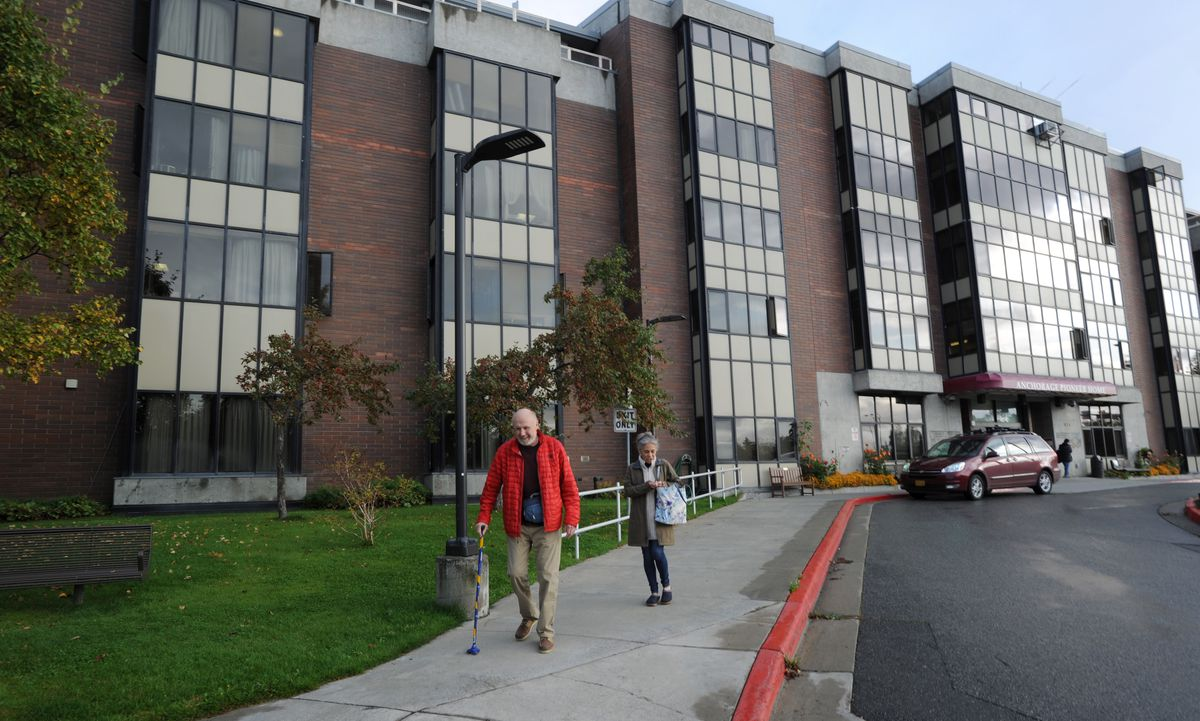 Mike Singsaas and Rocky Plotnick head out for an errand from the Anchorage Pioneer Home, Sept. 13, 2019. (Anne Raup / ADN)