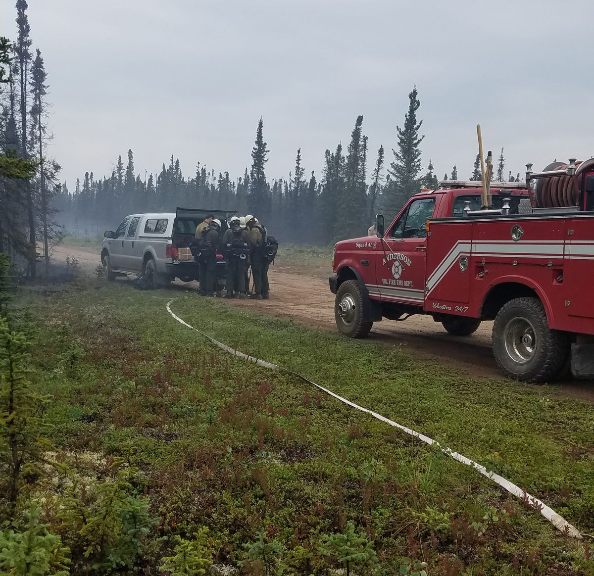 A brush truck from the Anderson Volunteer Fire Department is parked along Kobe Ag Road near the Kobe Fire on Friday morning, July 12, 2019 as members of the White Mountain Type 2 Initial Attack Crew gear up to head to the fire. (Photo courtesy Chief Scott Thompson/Anderson Volunteer Fire Department)