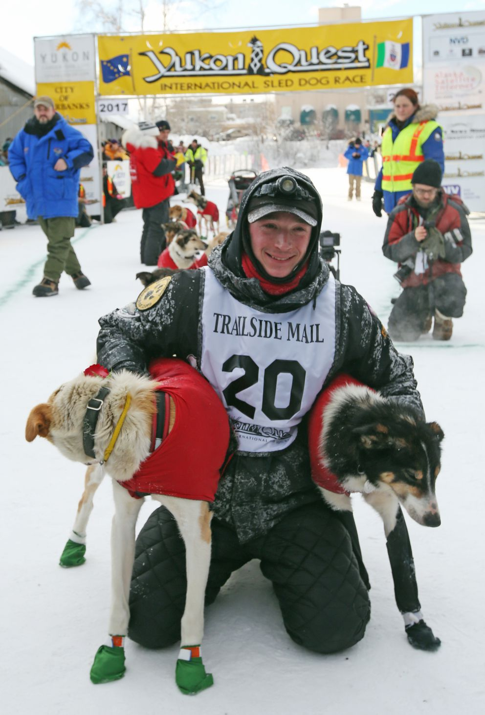 Matt Hall poses with his lead dogs Tuesday in Fairbanks after winning the Yukon Quest International Sled Dog Race. The 1,000-mile race began in Whitehorse, Yukon, on Feb. 4. (Eric Engman / Fairbanks Daily News-Miner)