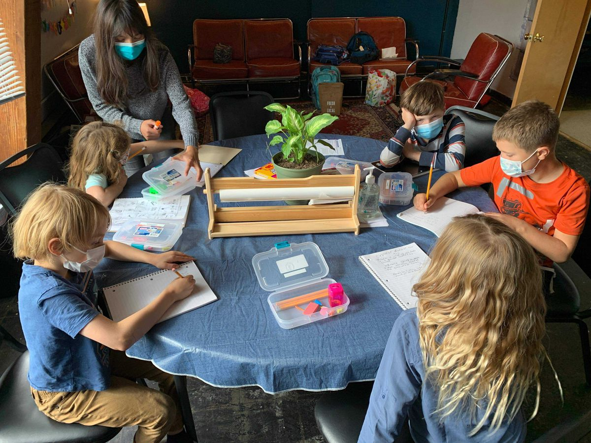 Elementary school-aged children work in a learning