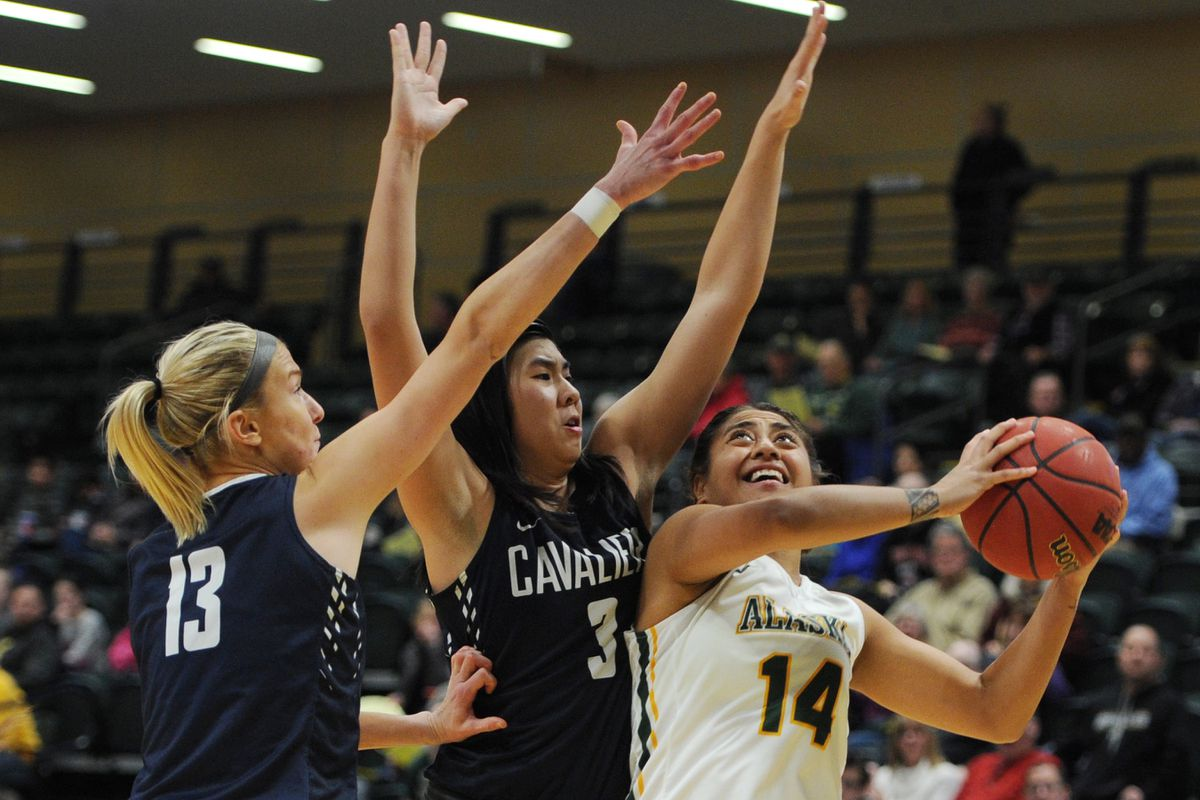 Players from Concordia try to defend UAA's Sala Langi during a women's basketball game earlier this season. Concordia is closing at the end of the spring semester. (Bill Roth / ADN)