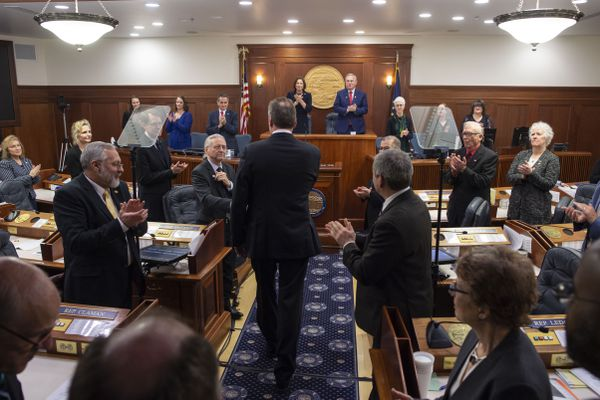 Gov. Mike Dunleavy shakes hands with legislators as he enters the House chambers to deliver his State of the State speech to a Joint Session of the Alaska Legislature at the Alaska State Capitol in Juneau, Alaska, Monday, Jan. 27, 2020. (AP Photo/Michael Penn)