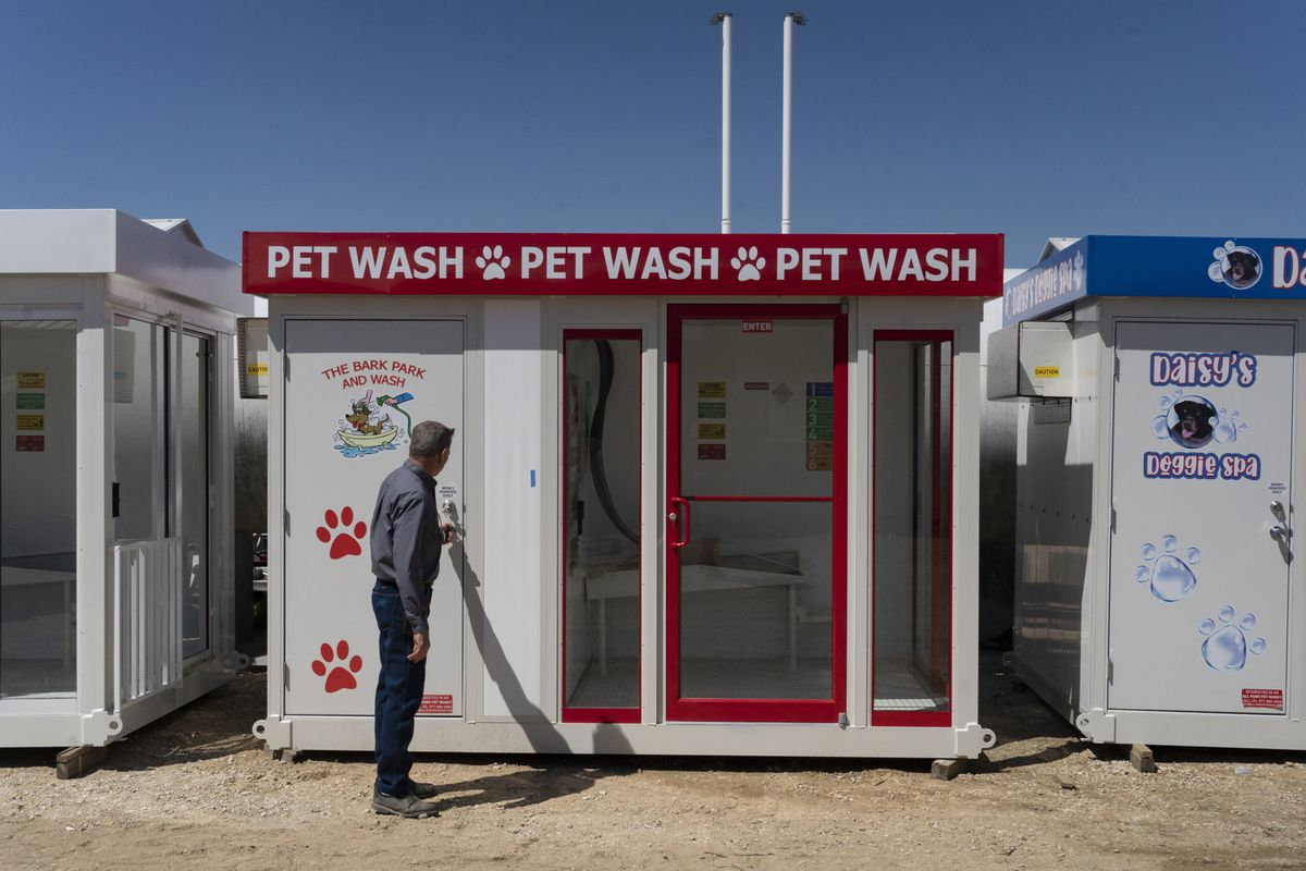 Russell Caldwell, the president of CCSI International, opens a door to the equipment room of a pet-washing booth in Garden Prairie, Ill., on Friday, April 30, 2021. ( Photo for The Washington Post by Youngrae Kim)