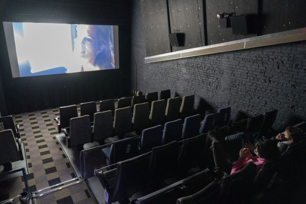 Brian Haver, left, and Matt Hoffman view a screening of