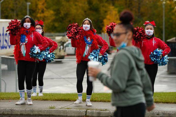 East High cheerleaders practice before an East-Bartlett football game on Friday, Sept. 25, 2020 at East High. (Loren Holmes / ADN)