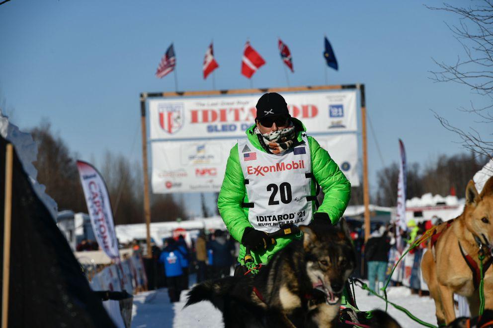 Ryan Redington leaves the Iditarod Sled Dog Race start area at Deshka Landing on Sunday. (Marc Lester / ADN)