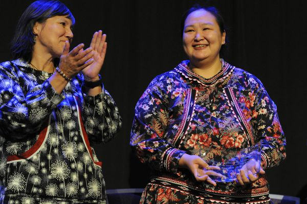 Mountain Village Officer Anna Bill holds a Shirley Demientieff Award that was presented to her by Gov. Bill Walker during the AFN Convention in the Dena'ina Center on Thursday, Oct. 18, 2018. Lt. Gov. Valerie Davidson is at left. (Bill Roth / ADN)