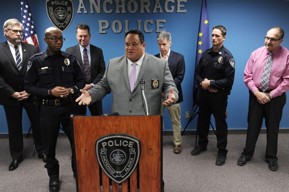 APD Lt. Jared Tuia spoke about vehicle thefts during a press conference at APD Headquarters on Tuesday, Feb. 5, 2019. Standing behind Lt. Tuia, from left, U.S. Attorney Bryan Schroder, Deputy Chief Ken McCoy, Anchorage D.A. John Novak, Mayor Ethan Berkowitz, Capt. Sean Case, and Capt. Dave Koch. (Bill Roth / ADN)