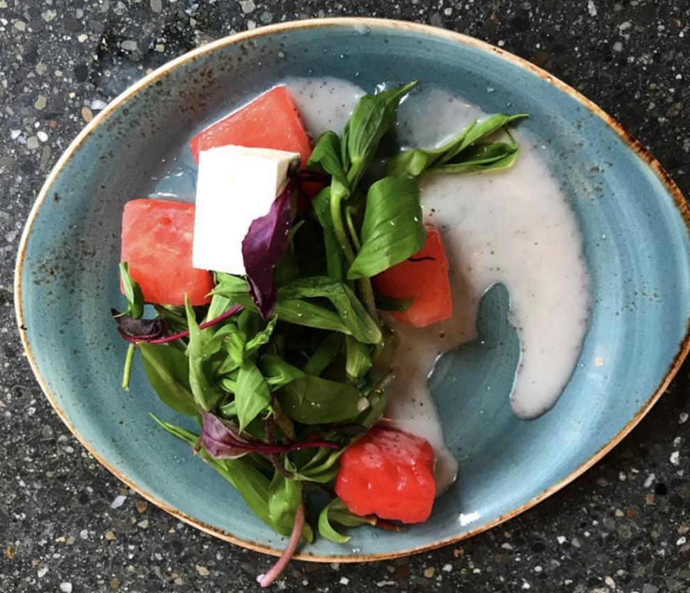 Watermelon shoot salad sample at Rustic Goat. (Julia O'Malley/ADN)