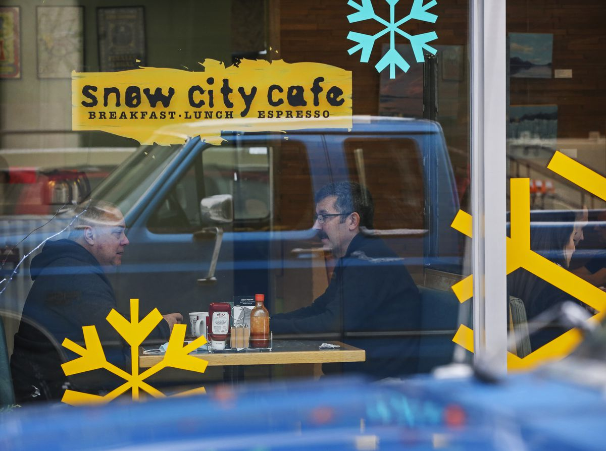 People sit at a table for lunch inside Snow City Cafe in downtown Anchorage on Thursday, Jan. 28, 2021. (Emily Mesner / ADN)