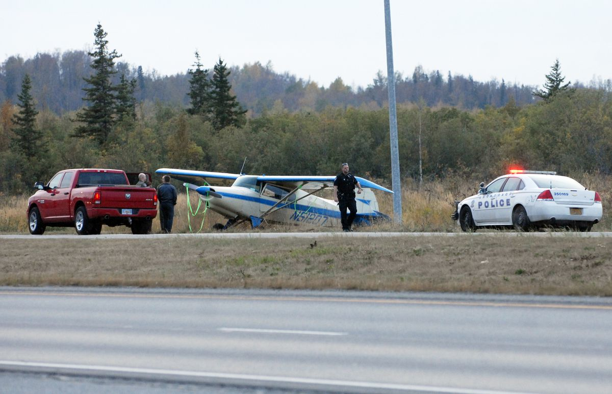 A small plane made an emergency landing on the Glenn Highway north of Eklutna on Friday, Sept. 6, 2019. No injuries were reported. (Matt Tunseth / ADN)