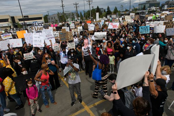 "A crowd gathered in the parking lot of the Midtown Mall and along the sides of Northern Lights Boulevard Saturday, May 30, 2020, for the ""I Can't Breathe"" protest against police brutality. (Marc Lester / Anchorage Daily News)"