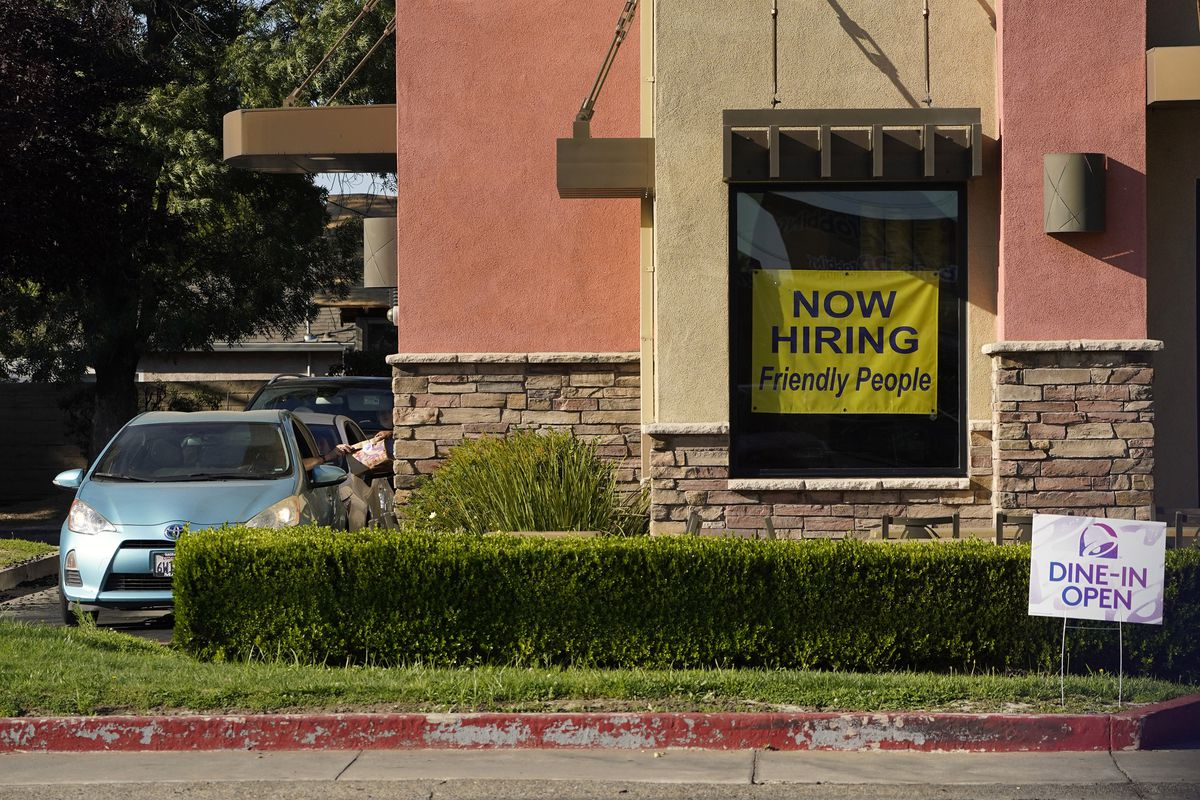 A hiring sign hangs in the window of a Taco Bell in Sacramento, Calif., Thursday, July 15, 2021. (AP Photo/Rich Pedroncelli))