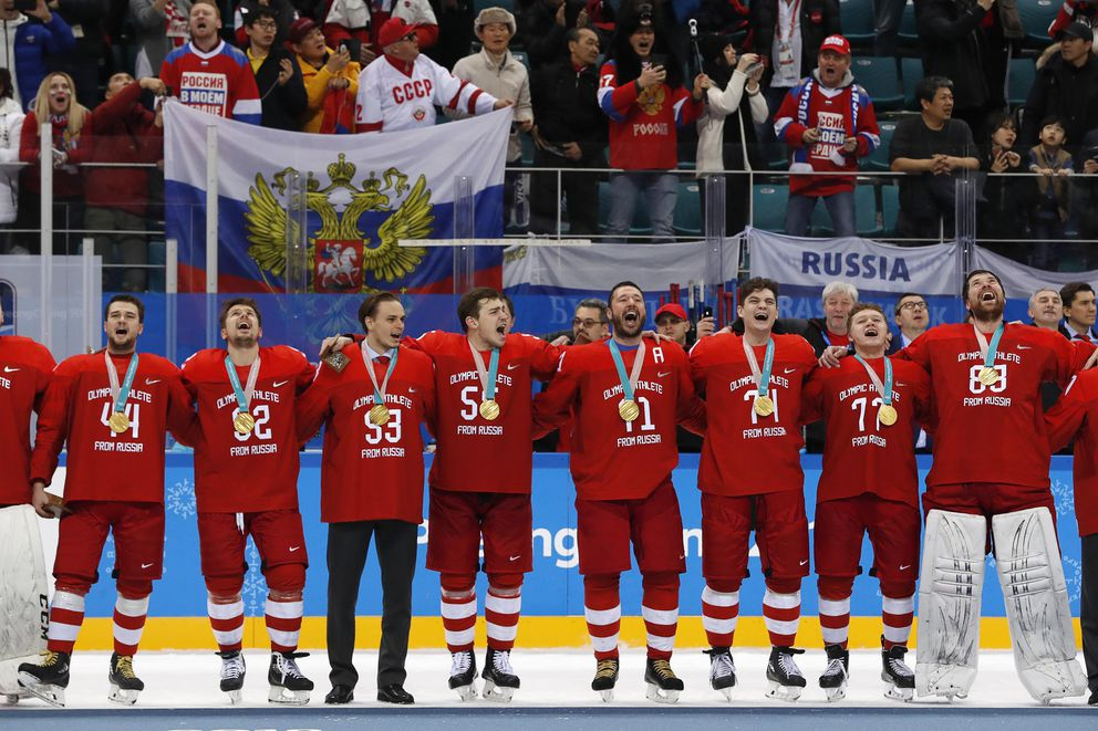 Ice Hockey - Pyeongchang 2018 Winter Olympics - Men's Final Match - Russia - Germany - Gangneung Hockey Centre, Gangneung, South Korea - February 25, 2018 - Russian team sings their national anthem while wearing their gold medals. REUTERS/Grigory Dukor