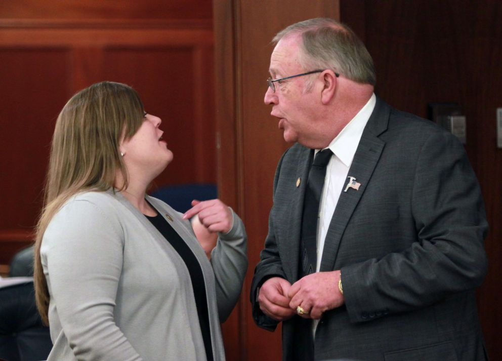 Anchorage Democratic Rep. Geran Tarr, left, banters with Rep. Mike Chenault, R-Nikiski, on the House floor Wednesday. Chenault's Republican minority caucus objected to a decision by Tarr's House majority coalition to list the House Resources Committee, rather than individual members' names, as the sponsor of newly-unveiled oil tax legislation. (Nathaniel Herz / Alaska Dispatch News)
