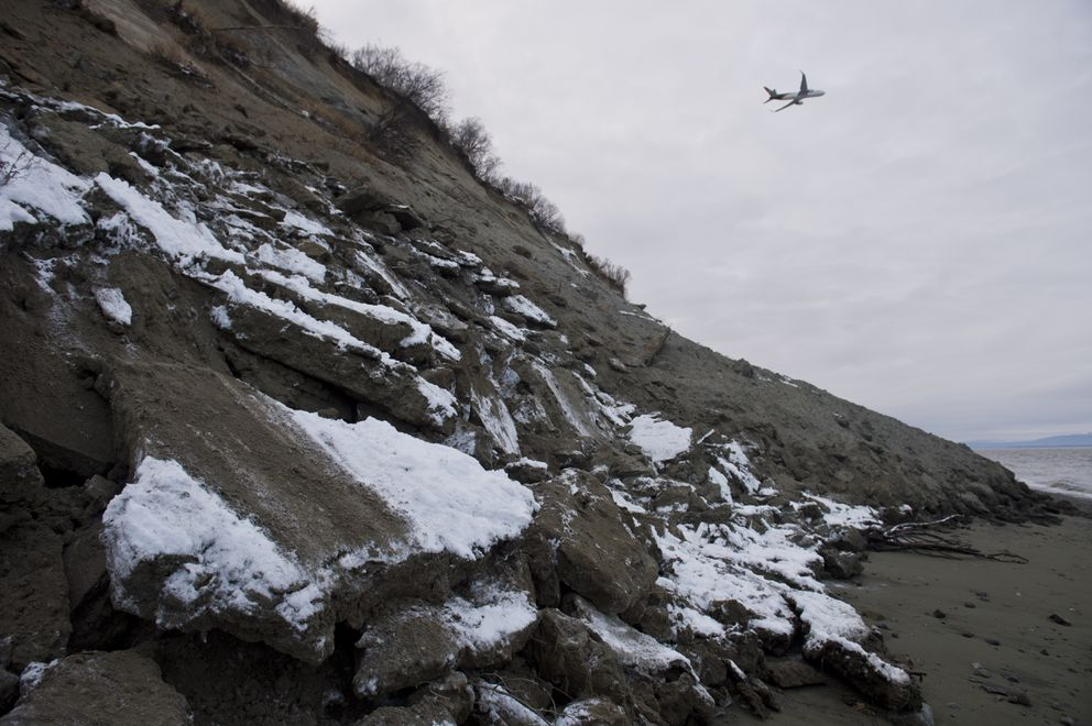 A plane departs from Ted Stevens Anchorage International Airport on November 30, 2018. Some earth appears to have slid to the beach near Point Woronzof during an earthquake earlier in the day. (Marc Lester / ADN)