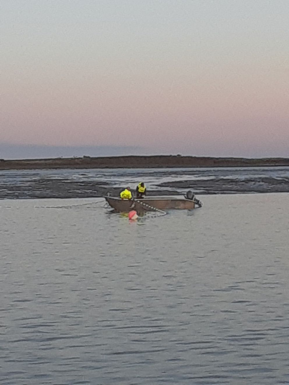 This a fairly typical Bristol Bay setnet operation at mid-tide. It's a 20-foot aluminum skiff powered by a 40-hp outboard motor, but larger skiffs are becoming more common. (Photo by John Schandelmeier)