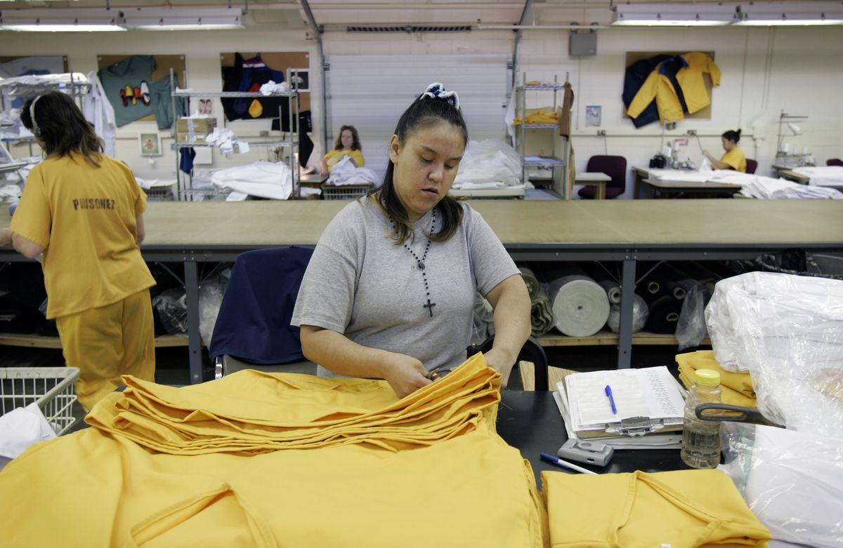 Maggie Fairbanks folds garments in preparation for packaging and shippingat Hiland Mountain CorrectionalCenter in 2005. (Daron Dean / ADN archive)