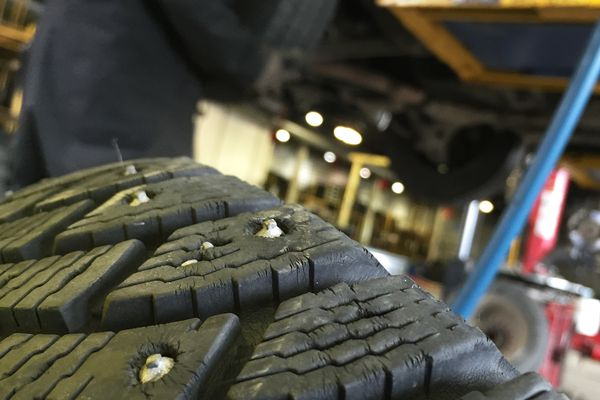 Summer tires are swapped out for studded winter tires at Johnson's Tire Service on October 6, 2015. Alaska's long winter season contributes to the road rut problem because studded tires, which are legal for most of the year, eat away at the region's road surfaces. Scott Jensen / ADN