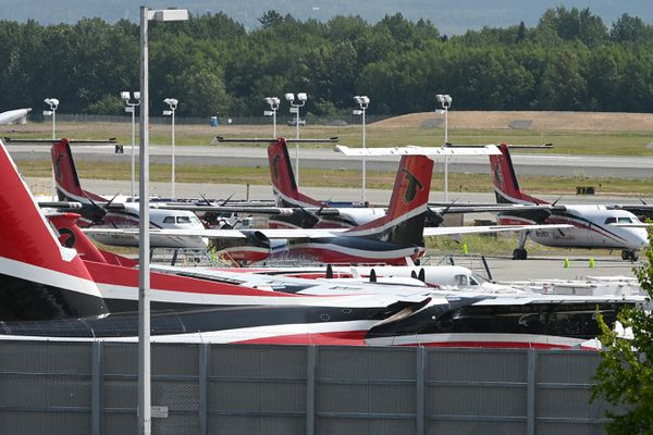 Ravn Alaska De Havilland Dash 8 aircraft and a Ravn Connect Beech 1900 parked at corporate headquarters at Ted Stevens Anchorage International Airport on Tuesday, July 7, 2020. (Bill Roth / ADN)