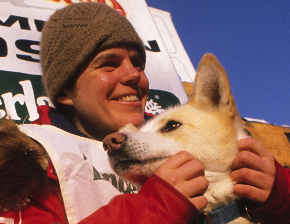 Susan Butcher and one of her lead dogs at the finish line after winning the 1990 Iditarod Sled Dog Race. (Bill Roth / ADN archive)